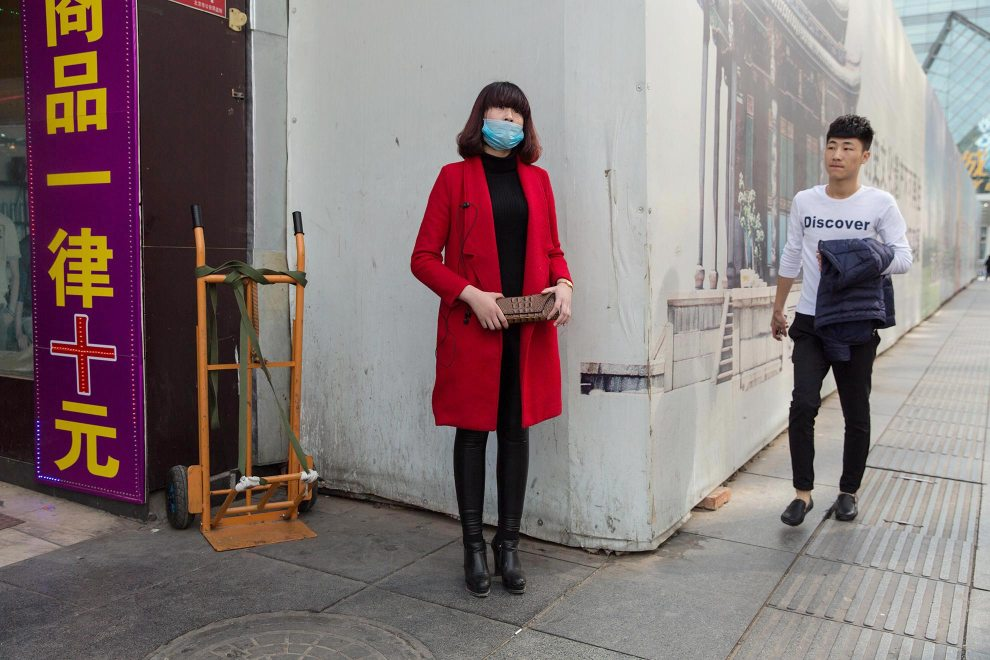 "Li, a 17-year old beautician from Shandong province, stands in Beijing's Xidan shopping district. ""I study here in Beijing. The air is bad""' she says. ""Two years ago I started wearing [the mask]. It helps protect my skin. There are too many people here in China which has ruined the environment.""  PM2.5 reading - 102 - Unhealthy for Sensitive Groups"
