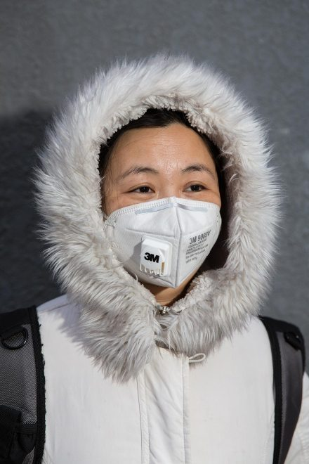 """Mrs. Huang (40), a life long Beijing resident. """"About 4-5 years ago I started using masks. I don't feel comfortable in my lungs."""", she explains. """"Of course there's been a big change in the air. Since the 1980's there were sandstorms. Then it got better. Around 2000, industry got more and more and the air got bad."""" PM2.5 reading - 188 - Unhealthy"""