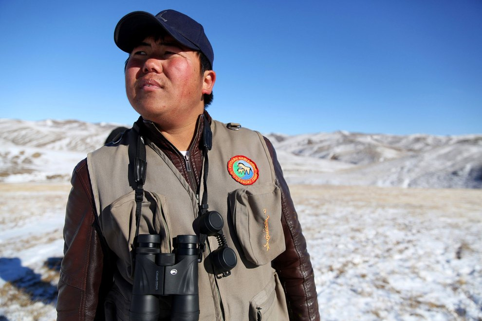 A ranger at the Hustai National park watched over the small herds of wild Mongolian horses nearby.
