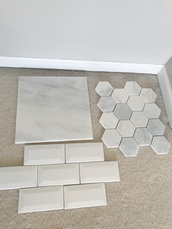Marble floor, hexagon for shower floor and beveled subway for shower walls