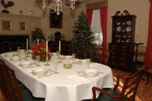 Dining Room    The dining room at Bassett Hall has been decked out in Christmas style with a lighted 1940's style Christmas tree and decorative arrangements by Clark Taggart, floral designer at the Williamsburg Inn.
