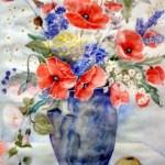 valmuer i blå vase
