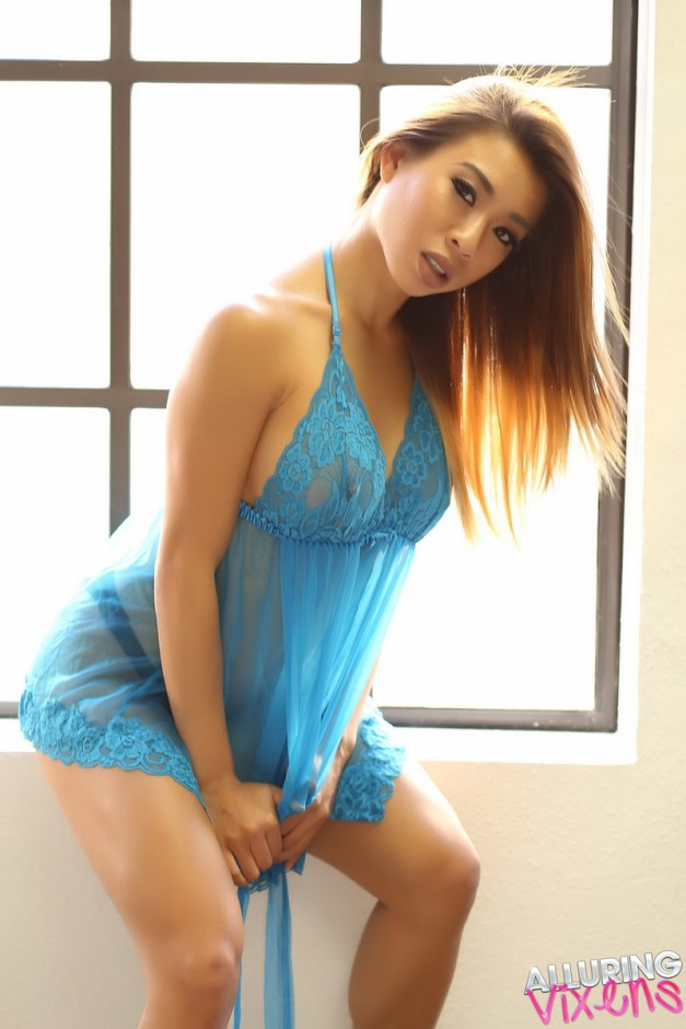 Stunning Alluring Vixen tease Annie shows off her perfect curves in a semi sheer baby doll