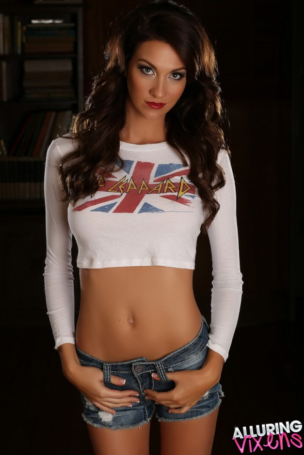 Perfect Alluring Vixen Bethany teases in her skimpy rock crop top with her tight body