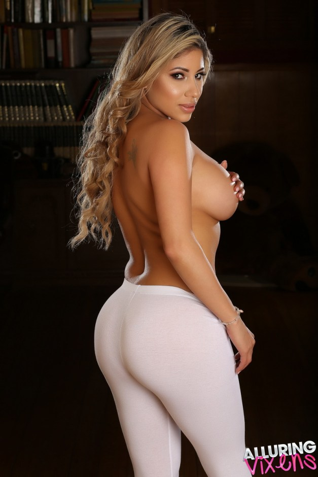 Curvy Alluring Vixen babe Erika shows off her big juicy ass in tight white leggings as she strips out of her skimpy bikini top