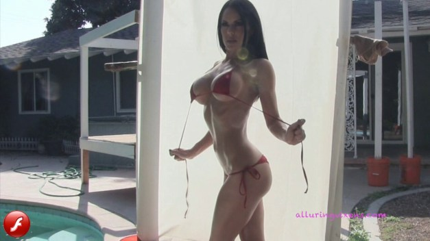 Watch as busty Alluring Vixen babe Jennifer teases in her very skimpy string bikini