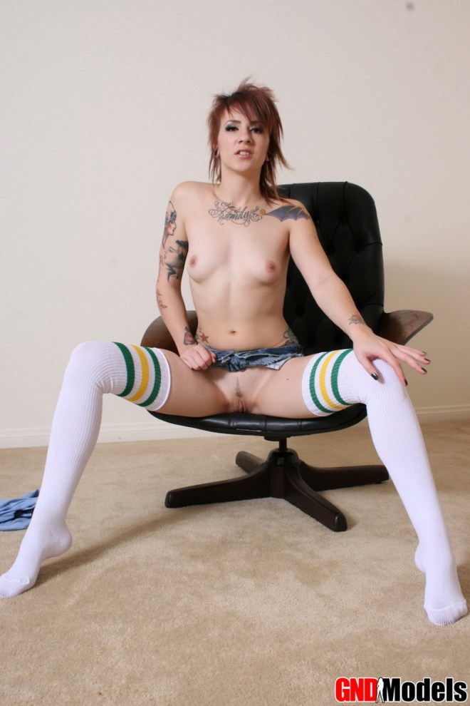 Tattooed topless babe Sailor has no panties on under her short jean skirt as she teases in thigh high socks