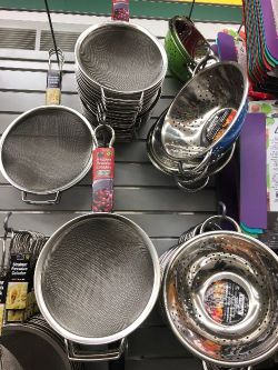Picture of metal colanders and strainers of various sizes at the dollar store.