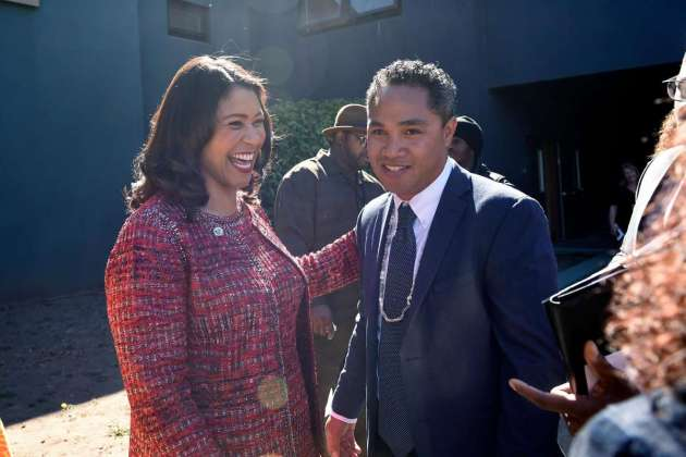 Mayor London Breed and Commissioner Faauuga Moliga celebrate
