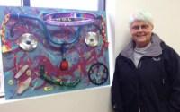 """Artist Winnie Chrzanowski with her adorable assemblage piece, """"Biker Babe"""""""