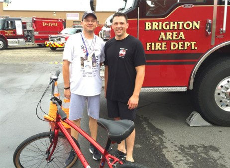 Brighton Fire Chief O'Brian with Brighton Mayor Jim Muzzin who won the Jamis cruiser donated by Hometown Bicycles for the 9/11 Memorial 5K run