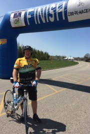 Tom Lemkau in Team Hometown Bicycles jersey riding Zoo-de-Mackinac