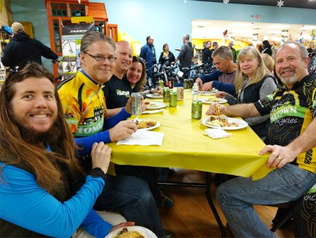 Team Hometown Bicycles members enjoying tacos and treats at Team Night