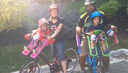 Hometown Bicycles' Shaun and Dawn Bhajan and family riding bicycles in the Fourth of July Parade