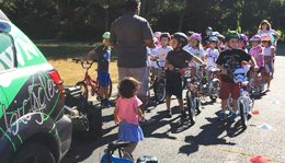 Hometown Bicycles' Shaun Bhajan at Brighton Safety Town at Hilton Elementary School
