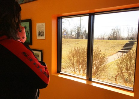 Shaun Bhajan looking out the window at Spring weather at Hometown Bicycles