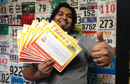 "Shaun holding the last of the ""I Believe in Hometown Bicycles"" Gift Certificates"