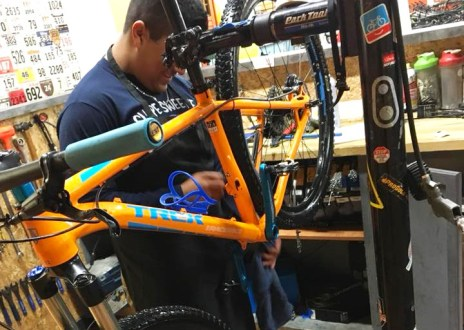 Hometown Bicycles' Service Tech Ozzy Aguilar working on a bike tune up