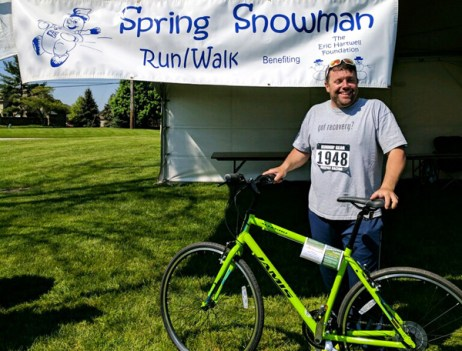 Adam Shinabarger of Walled Lake with his Hometown Bicycle's donated Jamis bike at the Eric Hartwell Foundation Spring Snowman Run/Walk