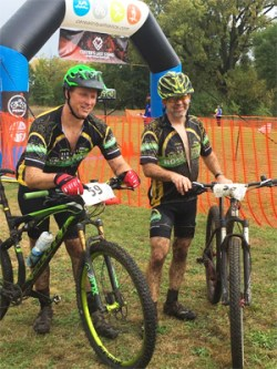 Team Hometown Bicycles' Jim Thompson and Mike Dyer muddy buddies at Custers Last Stand Against Human Trafficking Mountain Bike Race in Augusta, Michigan