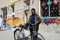 A bread seller on his bicycle