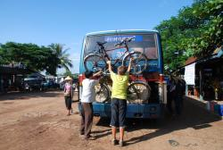 Loading the bikes onto a bus in Laos.