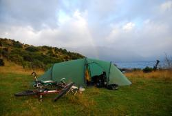 Bush camping with a rainbow near Queenstown