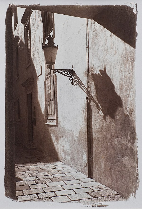 """""""Croatia Side Street"""" © Alan Glover. Approx 11x7.5"""" handcrafted Van Dyke Brown print from a single negative printed on Hahnemuhle Platinum Rag paper. GALLERY5X7 offers this original print, signed on the mount (mount size 16x12""""), at $250."""