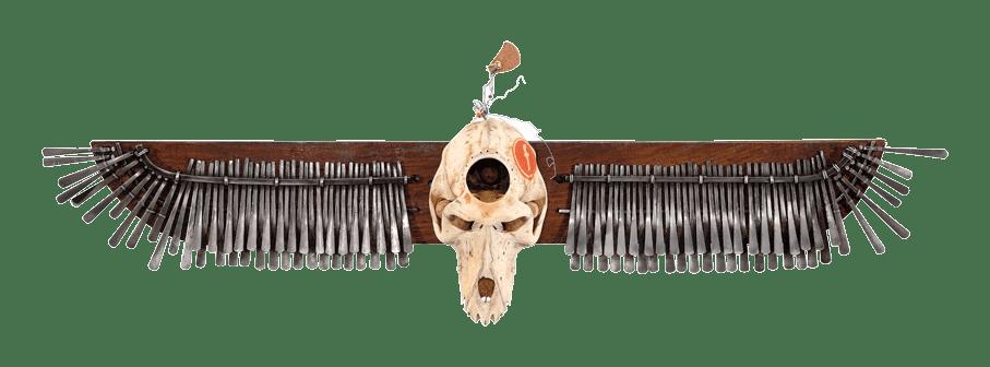 Masimba Hwati, Trepanation, 2014, Baboon Skull, Mbira, Wood, Leather, Glass Beads, 80 x 25 cms