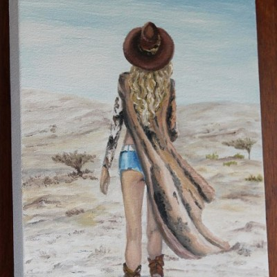painting of a cowgirl walking in the desert