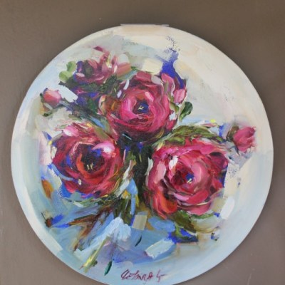 Painting of flower on round canvas