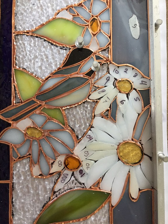 Closeup of pattern and petals in various stages of completion.