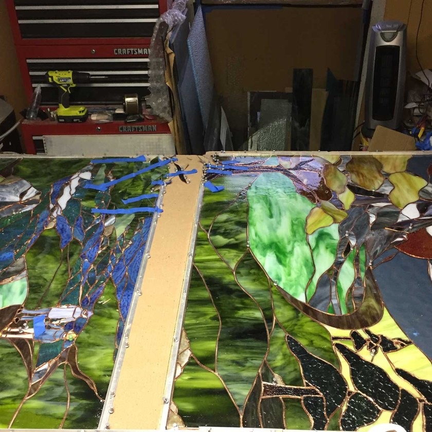 Two haves of large stained glass work coming together at Gallery's Choice studio