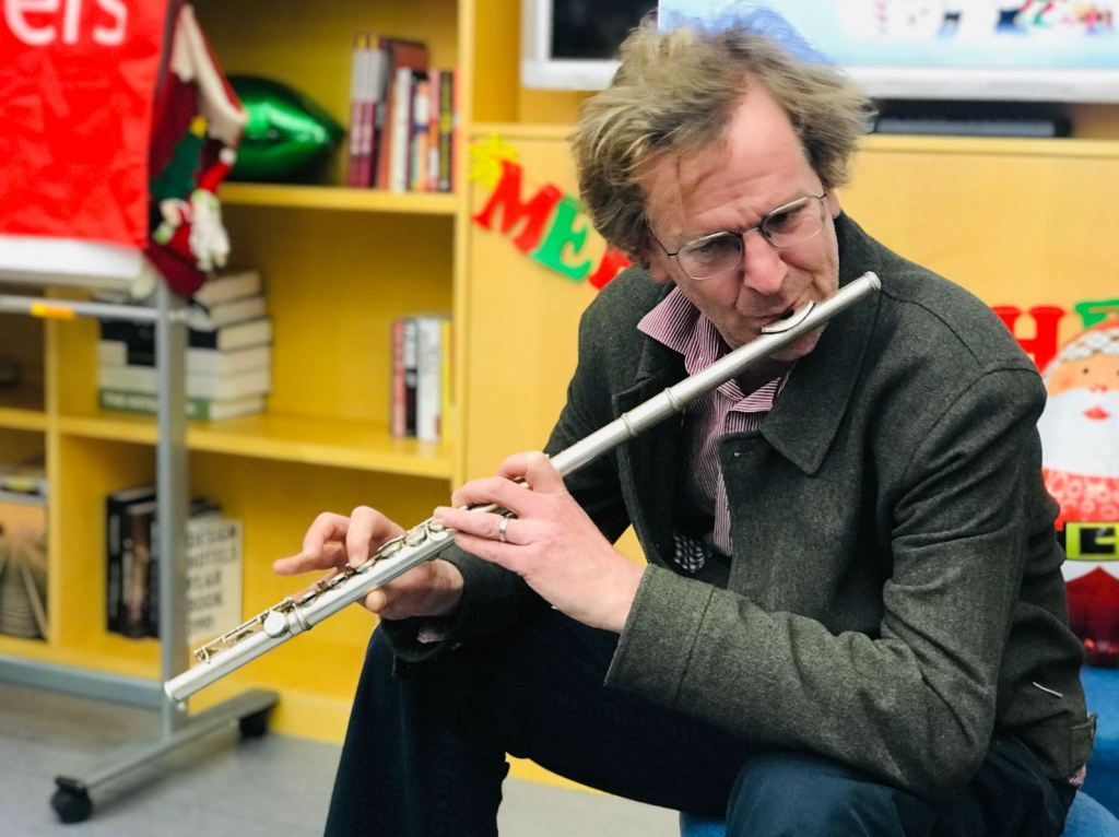 George plays flute