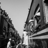 """devotees returning y a crowded train after attending final prayer at ijtema.Devotees attending on a final prayer (Akheri munajat) at"""" Ijtema"""" near Turag river in Tongi,Dhaka.The first phase of 49th Biswa Ijtema, one of the largest gatherings of Musli"""