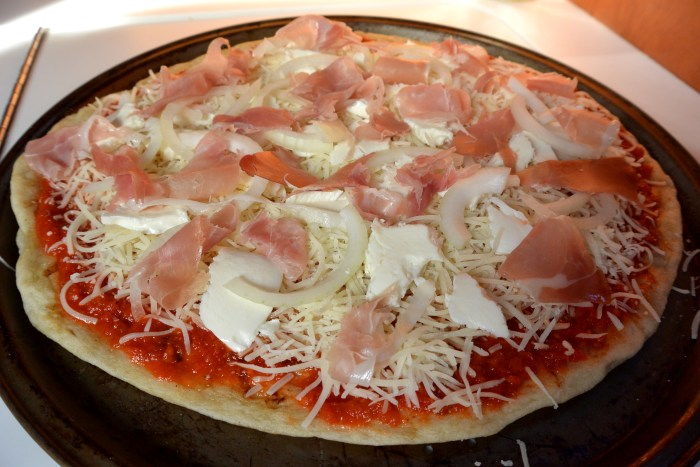 prosciutto pizza ready for first oven