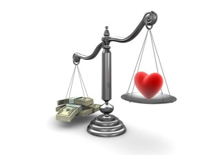 Scales weigh money and heart