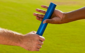 Hands Passing Baton at Sporting Event