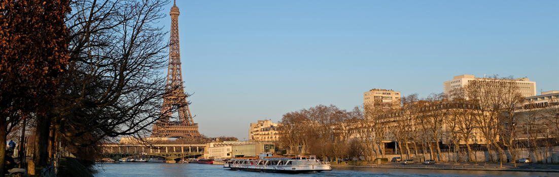 Eiffel Tower by River Seine with boat