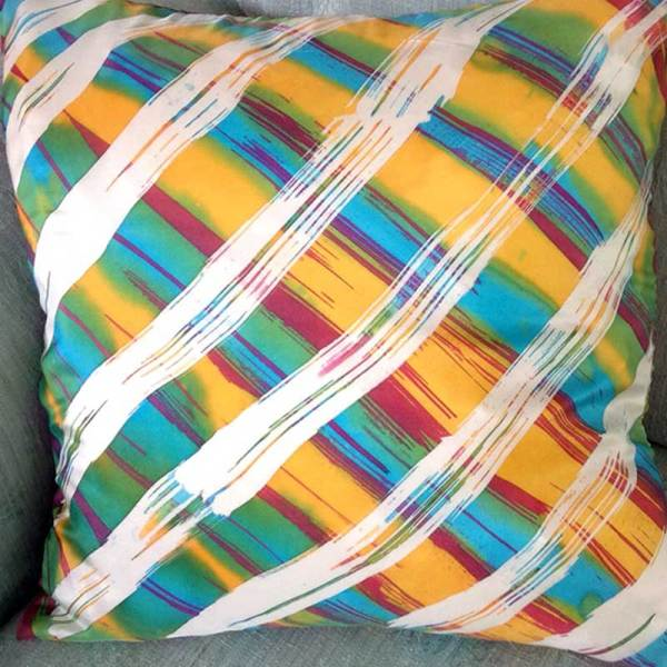 Image of silk pillow with striped batik wax resist dyed fabric - from Batik Workshop - Fun with Paper & Fabric featuring Rosi Robinson