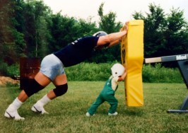 Mike Webster and his son in their backyard.