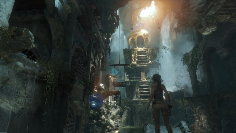 Lara looks up at a golden underground chapel