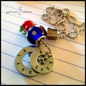 "INSPIRE - Two hand-stamped washers (teachers inspire). Pewter schoolhouse and red apple charms. Blue dot glass bead. 22"" stainless steel ball chain. $25 as shown."