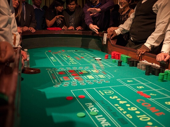 A typical craps game with odds bets behind the pass line