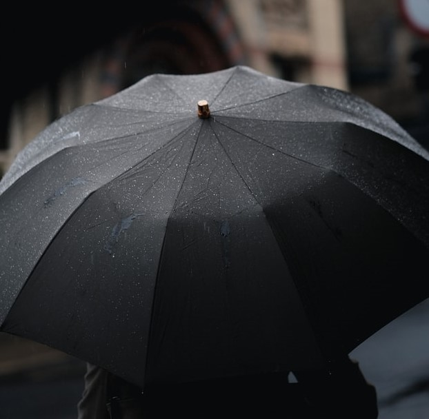 Black Umbrella on a rainy day to symbolize the protection of security policies and terms of Game Changer Products LLC.