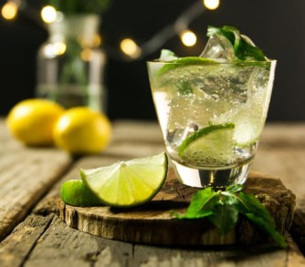 A mojito cocktail served on a warm summer night.  It's one of the five refreshing cocktails you can make at home.
