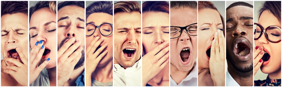 A group of people, all yawning, and showing how losing sleep can affect everyone.