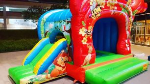 large bouncy castle with slide for rent