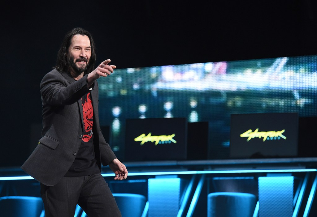 """Keanu Reeves, """"Cyberpunk 2077"""" Actor, delights fans by unveiling the game release date at the Xbox 2019 E3 Briefing at the Microsoft Theater at L.A. Live, Sunday, June 9, 2019 in Los Angeles. (Photo by Casey Rodgers/Invision for Xbox/AP Images)"""