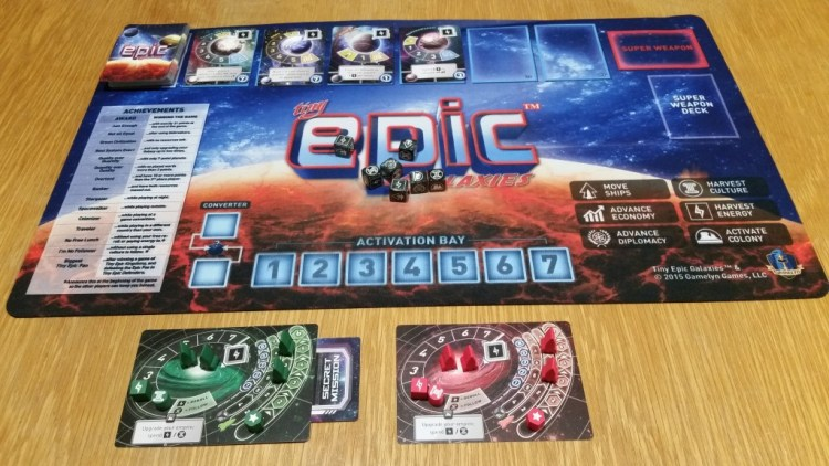 It's got more than just nice dice. All set up for a 2-player game, featuring the awesome deluxe playmat